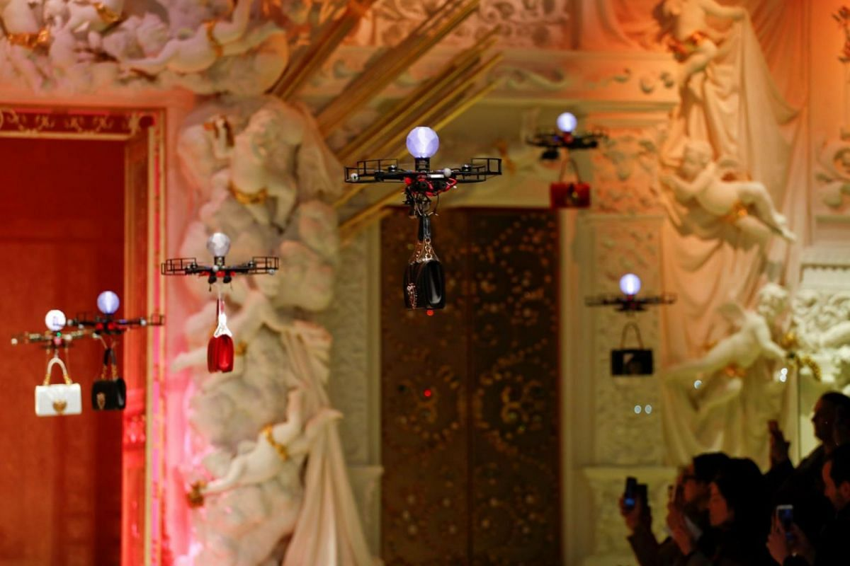 Drones carrying bags from the Dolce & Gabbana Autumn/Winter 2018 women's collection during Milan Fashion Week in Milan, Italy, on Feb 25, 2018.
