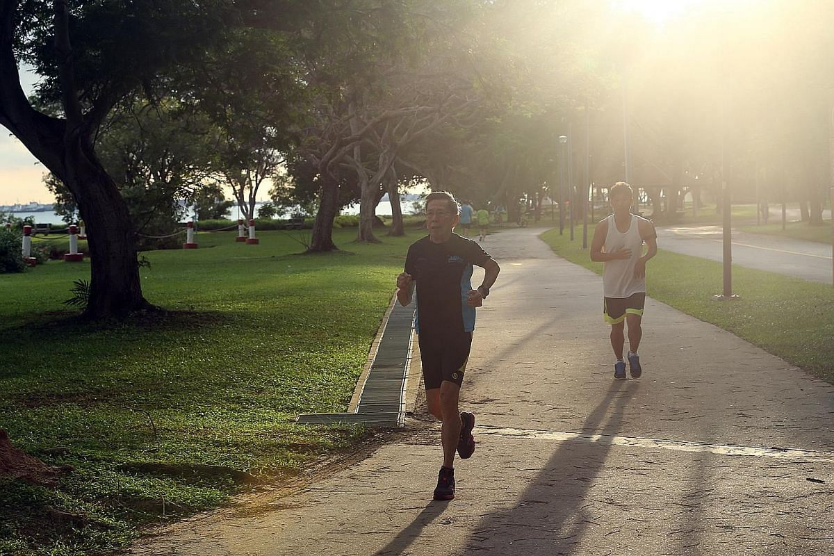 """Mr Kor and his youngest grandson Aston Kor, 18, cooling down after a run. The teenager thinks his """"Dada"""", as Mr Kor is affectionately known by his grandchildren, is """"determined and self-driven"""" and his best role model. Mr Kor, who believes Aston has"""