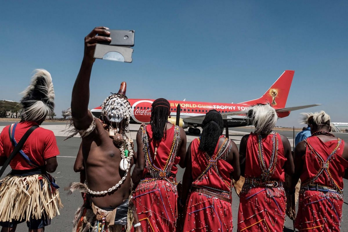A dancer takes a selfie upon the arrival of the special aircraft carrying the Fifa World Cup Trophy during its World Tour, on Feb 26, 2018, at the Jomo Kenyatta International airport in Nairobi.