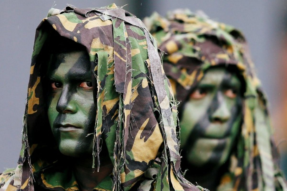 Sri Lanka's Special Task Force members look on at a rescue demonstration during the 35th anniversary in Kalutara, Sri Lanka on Feb 27, 2018.