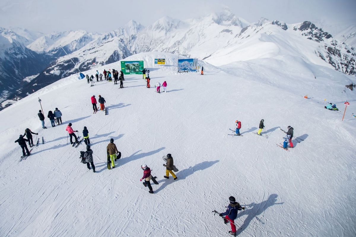 Snowboarders and skiers make their way to the slope at the alpine mountain range of High Tauern, near the village of Kals in the Austrian province of East Tyrol, Austria, on Feb 27, 2018.