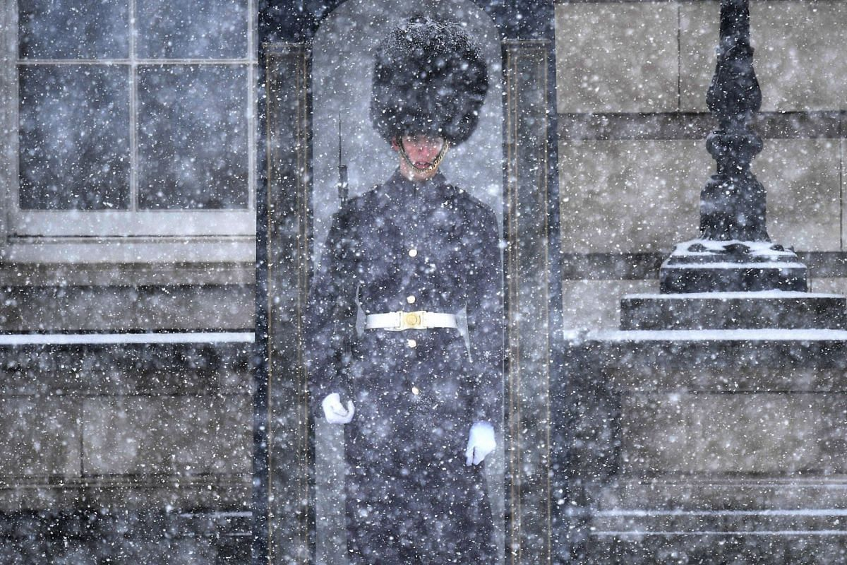 A British Guards Regiment soldier on guard duty at Buckingham Palace during a snow flurry in London, Britain, on Feb 27, 2018.