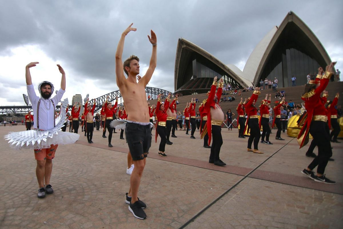 Members of staff from the Sydney Opera House participate in a dress rehearsal in central Sydney, Australia, Mar 2, 2018, as part of preparations for their participation in the 40th anniversary of the Sydney Gay and Lesbian Mardi Gras Parade on Mar 3.