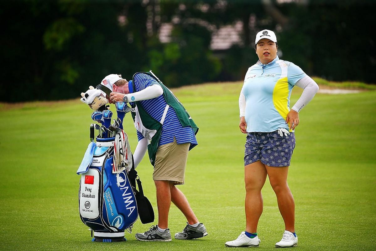 World No. 1 Feng Shanshan preparing for her round on the 13th fairway on Day 2 of the HSBC Women's World Championship yesterday. The Chinese is currently tied for 15th ahead of the third round.