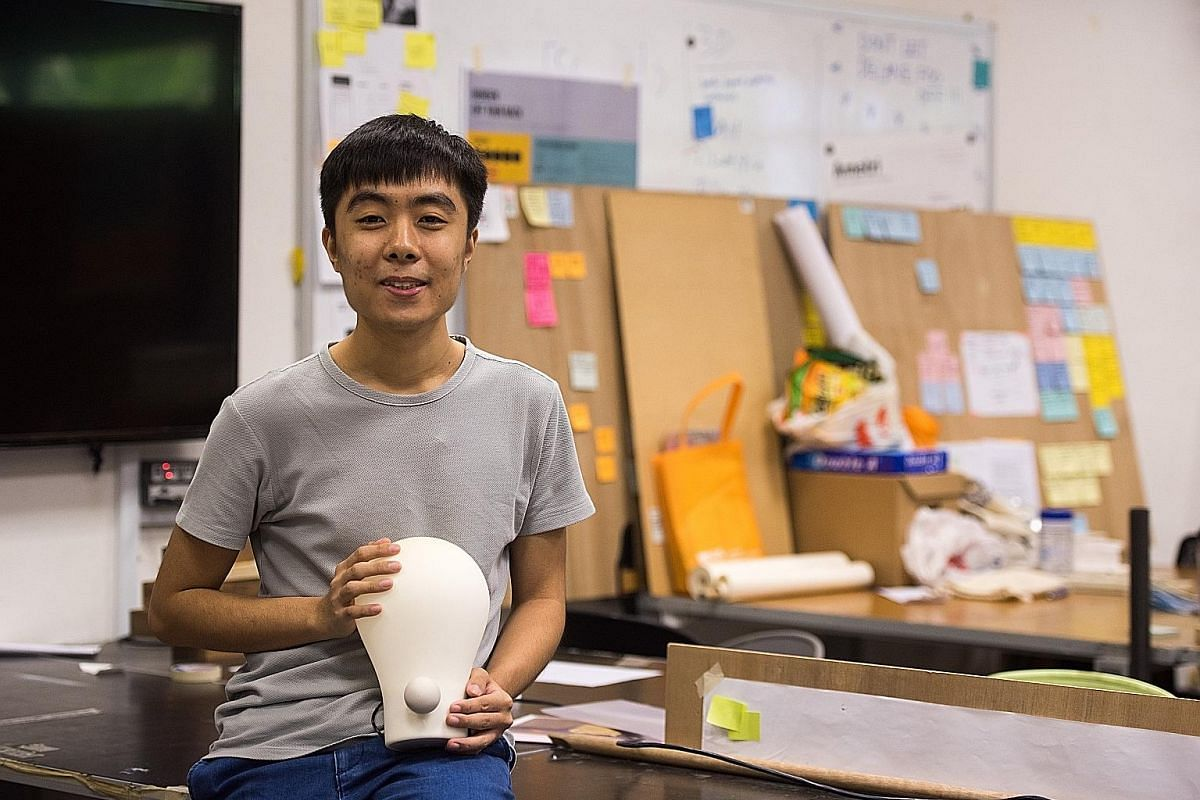 Mr Edmund Zhang with his Squeezy Lamp, which lights up when the user squeezes its ball-shaped knob in a series of pumping motions.