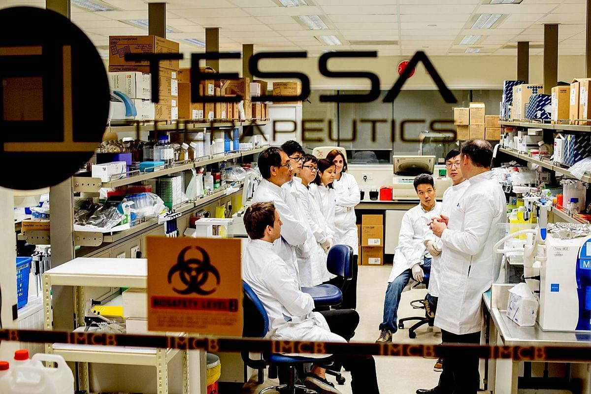 Singapore-based Tessa Therapeutics' research team gathering for a discussion at the joint immuno-oncology laboratory in A*Star's Institute of Molecular and Cell Biology. Invitrocue's team includes scientific development director of the cell-based uni