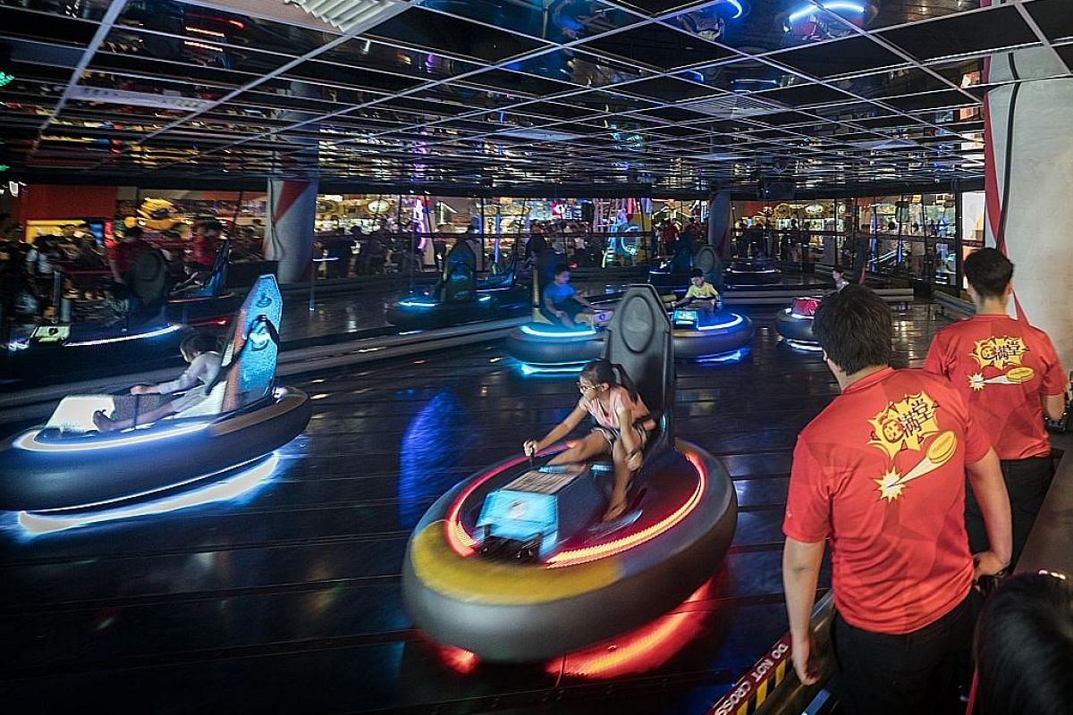At Timezone's new flagship arcade at VivoCity, visitors can ride in a revamped bumper car arena.