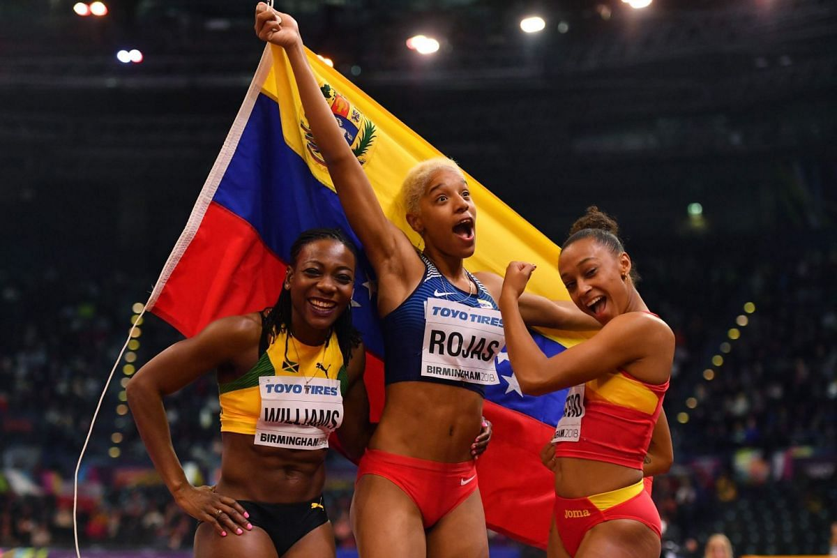 (L-R) Second placed Jamaica's Kimberly Williams, winner Venezuela's Yulimar Rojas and third placed Spain's Ana Peleteiro pose after the women's triple jump final at the 2018 IAAF World Indoor Athletics Championships at the Arena in Birmingham on Marc