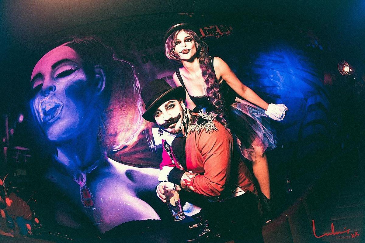 Sarissa Rodriguez Schwartz and Joshua Schwartz at Lulu's Lounge's Halloween party last year.