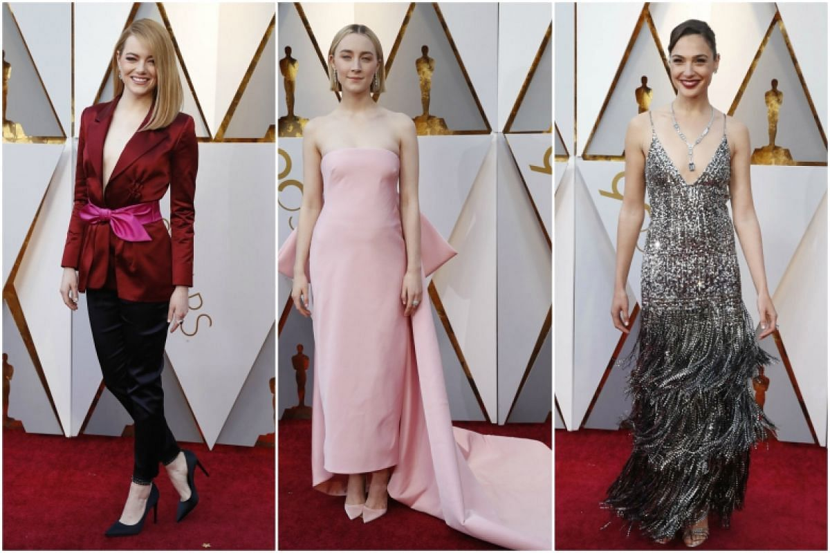 (From left) Emma Stone, Saoirse Ronan and Gal Gadot attend the 90th Annual Academy Awards at the Dolby Theatre in Hollywood, California on March 4, 2018.
