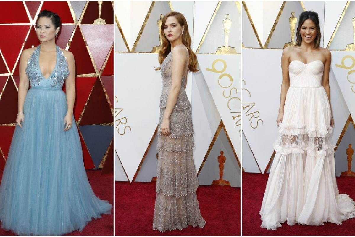 (From L-R) Kelly Marie Tran, Zoey Deutch and Erin Lim arrive on the red carpet at the 90th annual Academy Awards ceremony at the Dolby Theatre in Hollywood, California.