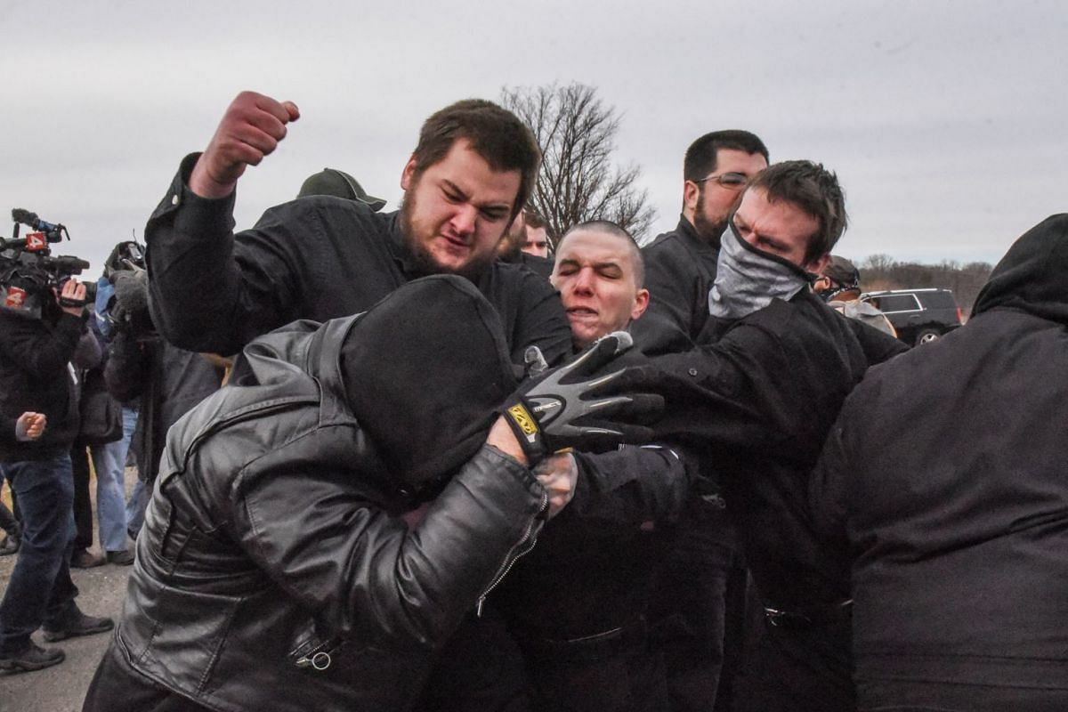 Members of the alt-right including members of the Traditionalist Workers Party fight with protesters outside of a Richard Spencer speech on the campus of Michigan State University in East Lansing, Michigan, U.S., March 5, 2018. PHOTO: REUTERS