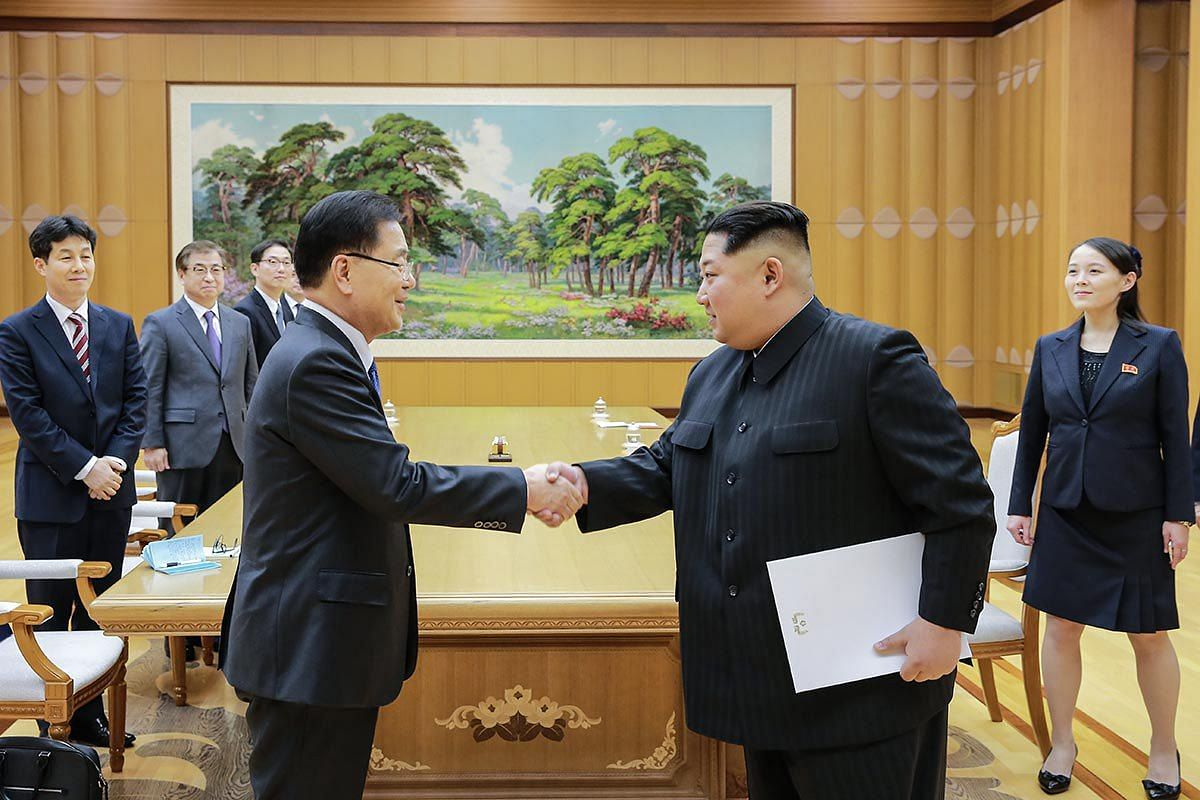 A handout photo made available by the South Korean Presidential Office Cheong Wa Dae shows North Korean leader Kim Jong-un (front, R) shaking hands with Chung Eui-yong (front, L), the head of the South Korean presidential National Security Office, af