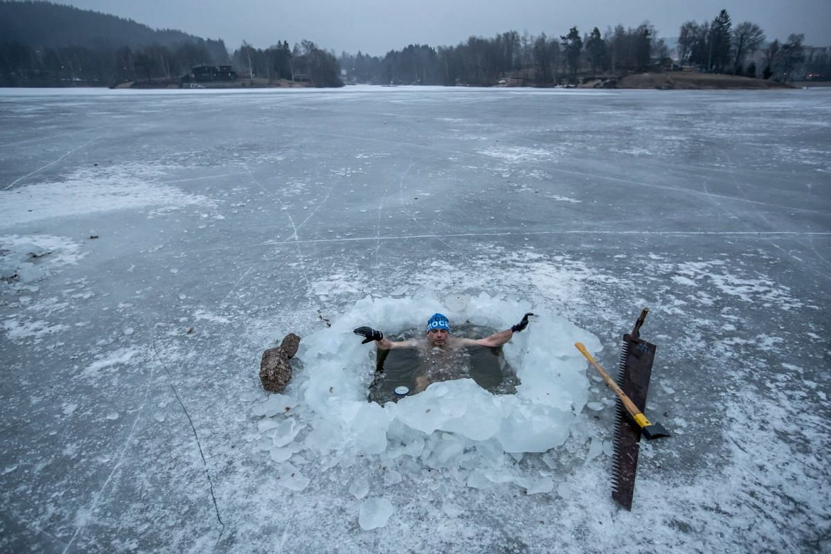 Petr Voboril bathes in icy water in Jablonec nad Nisou, Czech Republic, March 5, 2018. PHOTO: EPA-EFE