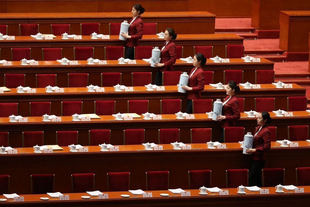 Attendants serve tea before the opening of the first session of the 13th National People's Congress (NPC) at the Great Hall of the People in Beijing on March 5, 2018.