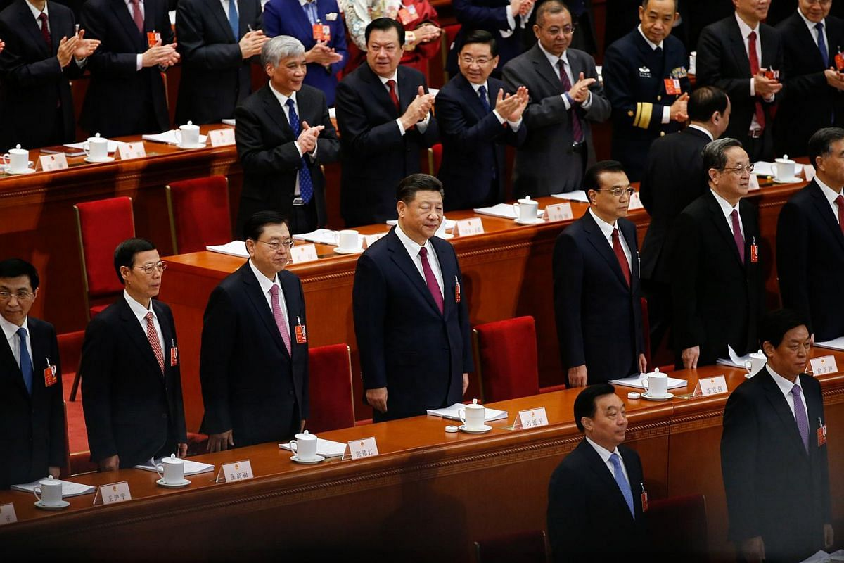 Chinese President Xi Jinping (centre) and Chinese Premier Li Keqiang (right) with other delegates at the opening of the first Plenary Session of the 13th National People's Congress (NPC) at the Great Hall of the People (GHOP) in Beijing on March 5,