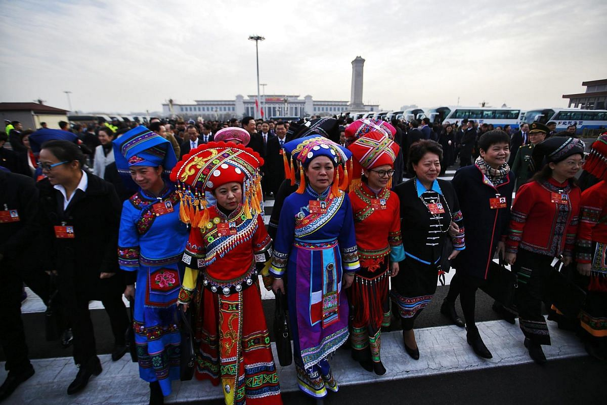 Ethnic minority delegates arrive for the opening of the first session of the 13th National People's Congress (NPC) at the Great Hall of the People in Beijing on March 5, 2018.