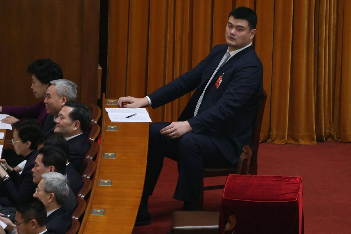 Yao Ming (right), Chinese basketball star, attends the opening of the First Session of the 13th Chinese People's Political Consultative Conference (CPPCC) National Committee at the Great Hall of the People (GHOP) in Beijing on March 3, 2018.