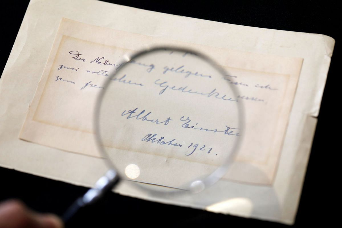 A note written by Albert Einstein to Italian chemistry student Elisabetta Piccini in Florence, Italy, in 1921 is seen before it is sold at an auction in Jerusalem, March 6, 2018. PHOTO: REUTERS