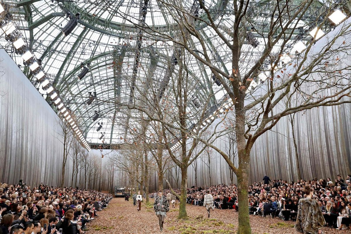 Models present creations for Chanel during the 2018/2019 fall/winter collection fashion show on March 6, 2018 in Paris. PHOTO: AFP