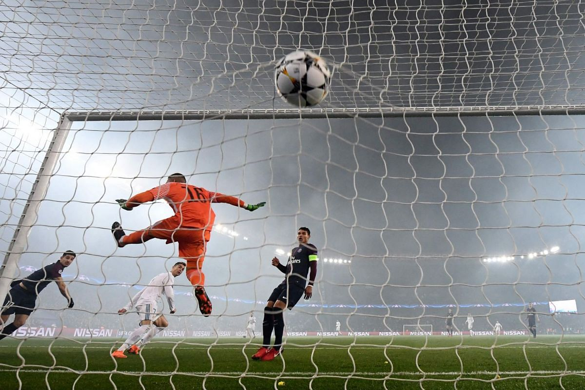 Real Madrid's Portuguese forward Cristiano Ronaldo heads the ball and scored a goal past Paris Saint-Germain's French goalkeeper Alphonse Areola during the UEFA Champions League football match Paris Saint-Germain vs Real Madrid, on March 6, 2018 at t