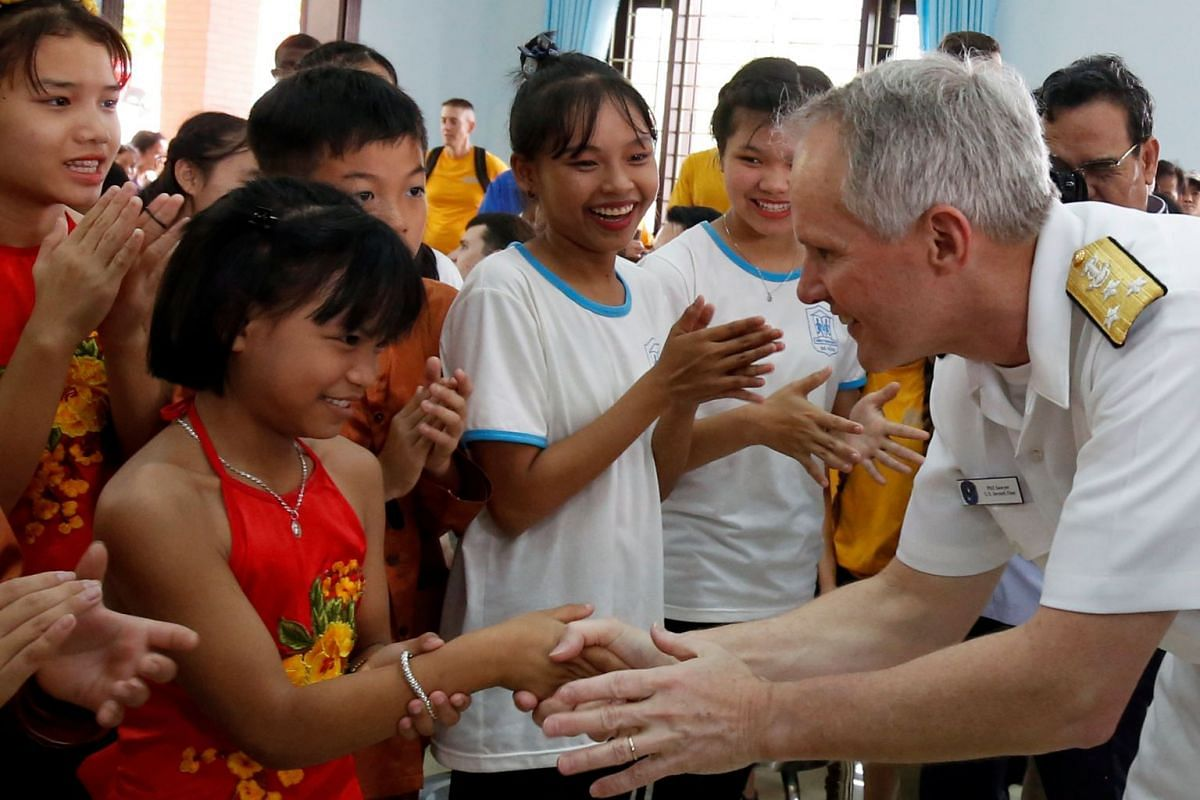 Children greet Vice Admiral Phillip G. Sawyer, Commander of the US 7th Fleet, at the Da Nang SOS Children's Village as part of the visit to Vietnam of US aircraft carrier Carl Vinson, in Danang, Vietnam, on March 6, 2018.