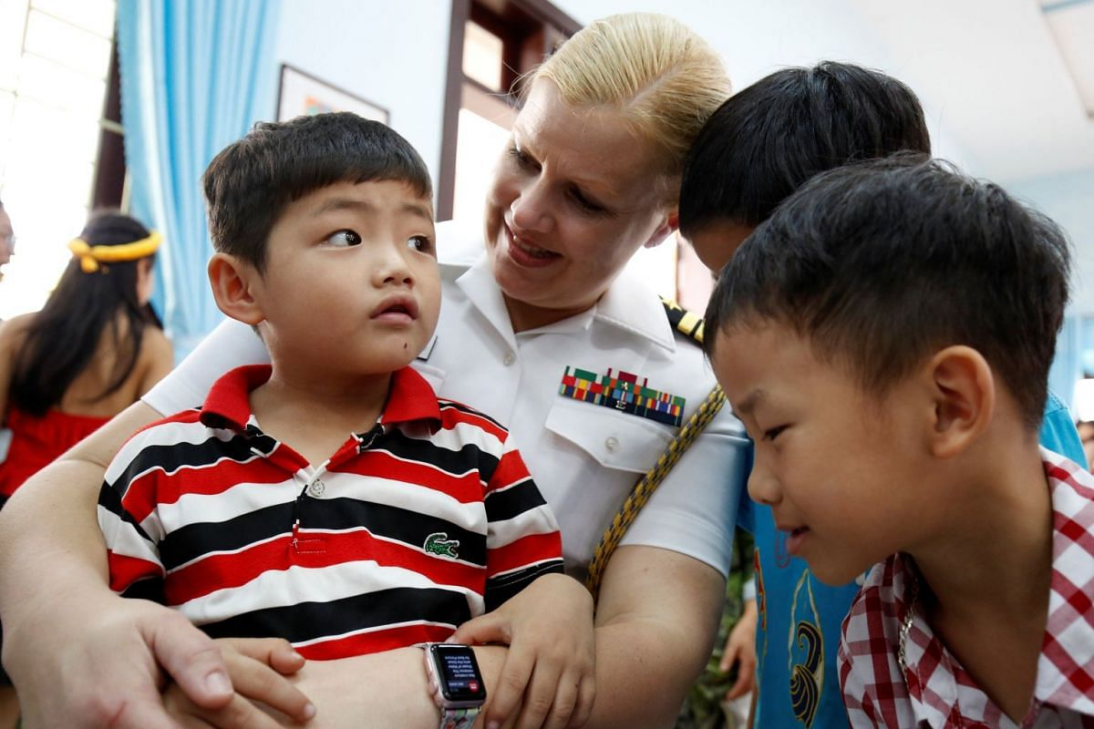 US Navy officer Angela Edwards hugs a child at the Da Nang SOS Children's Village as part of the visit to Vietnam of US aircraft carrier Carl Vinson, in Danang, Vietnam, on March 6, 2018.