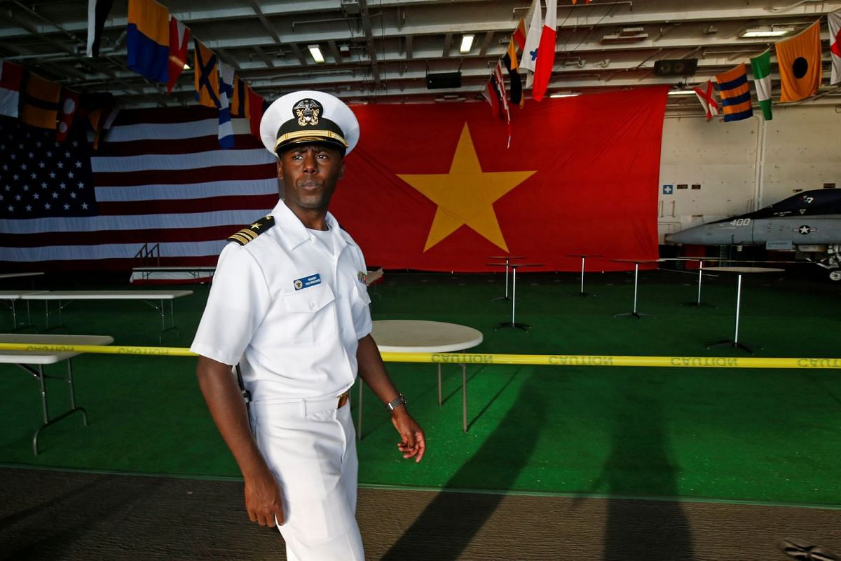 A sailor guard walks aboard the US Navy aircraft carrier, USS Carl Vinson, after it docked at a port in Danang, Vietnam, on March 5, 2018.