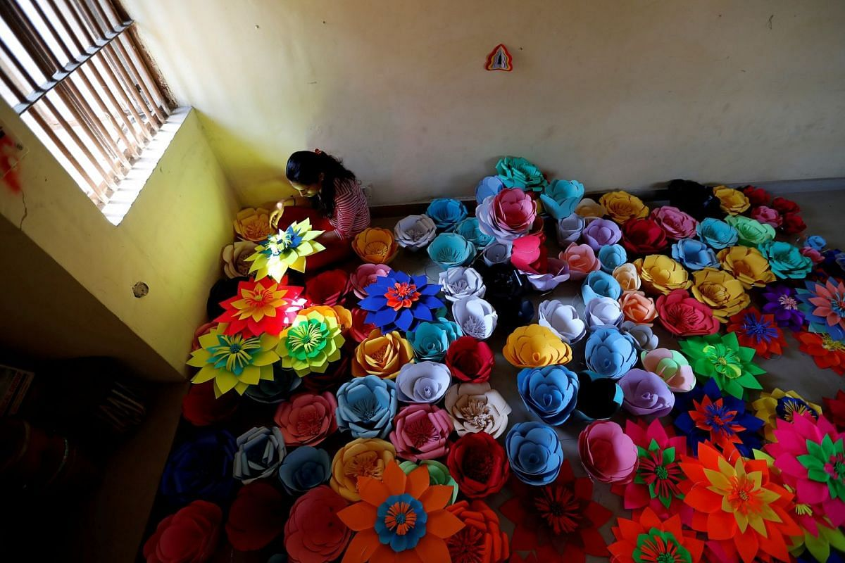 An inmate at Tihar Jail, the largest complex of prisons in South Asia, makes decorations for an event to mark International Women's Day in New Delhi, India March 7, 2018. PHOTO: REUTERS