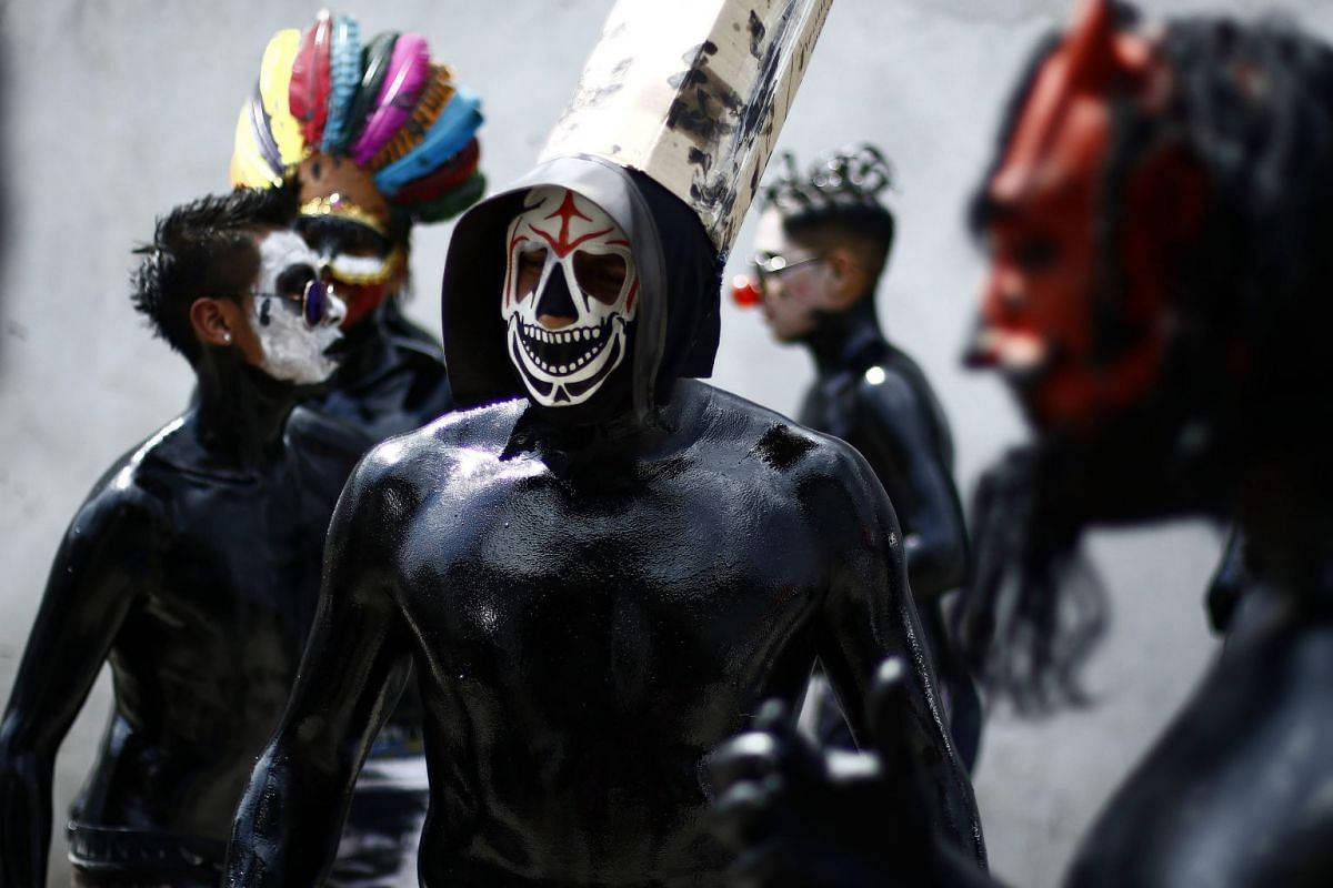 Youth covered in body paint participate in a carnival and perform the Xinacetes, a pre-hispanic dance, in the town of San Nicolas de los Ranchos, in Puebla, Mexico, March 6, 2018. PHOTO: EPA-EFE