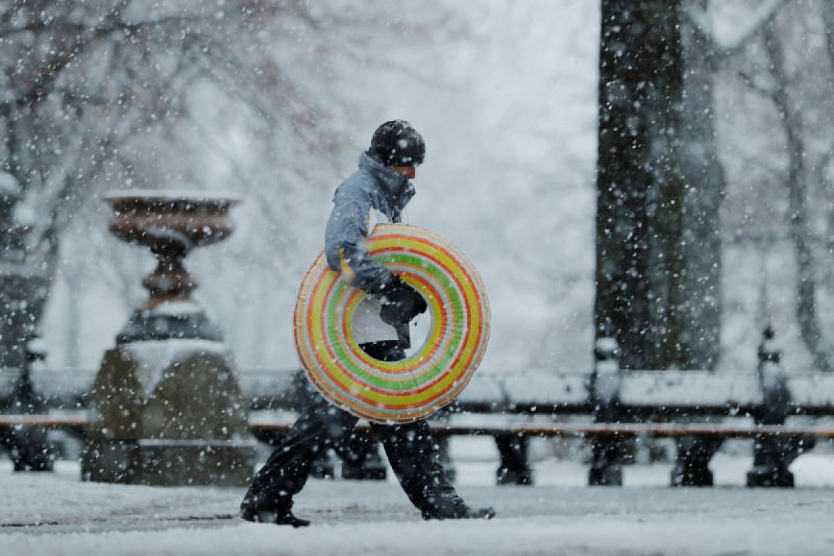 A pedestrian walks through Central Park during a snow storm in New York, US, on March 7, 2018.