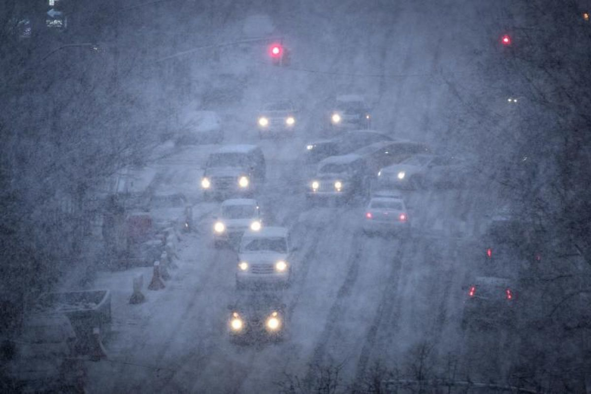 Vehicles navigate the road conditions on Atlantic Avenue in Brooklyn during a snowstorm in New York City on March 7, 2018.