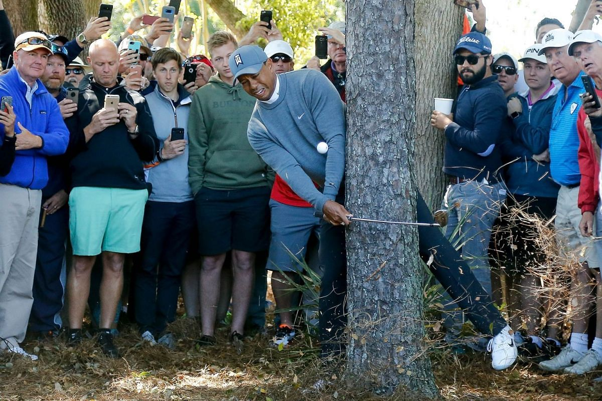 Tiger Woods plays his second shot on the fourth hole during the first round of the Valspar Championship at Innisbrook Resort Copperhead Course on March 8, 2018 in Palm Harbor, Florida. PHOTO: GETTY IMAGES/AFP