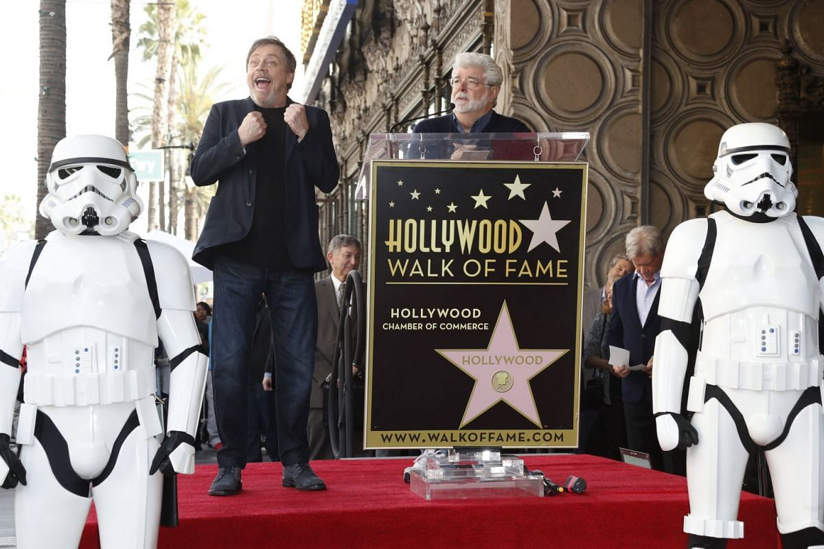 US actor Mark Hamill (L) reacts as he is introduced by US director George Lucas (R) during a ceremony honoring Hamill with a star on the Hollywood Walk of Fame in Hollywood, California, USA, March 8, 2018. PHOTO: EPA-EFE