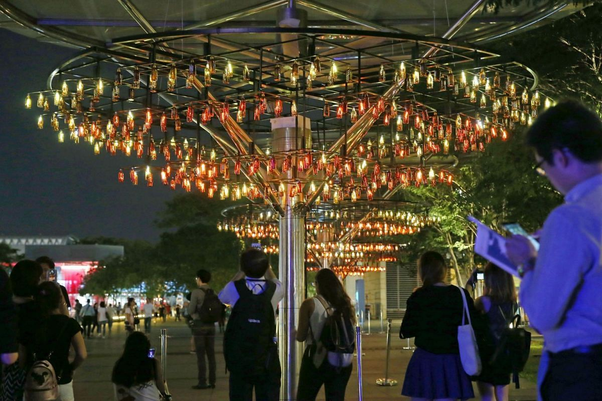 Chandelier Of Spirits is made of recycled cold-brew coffee bottles which shines brighter when there are more people surrounding it.