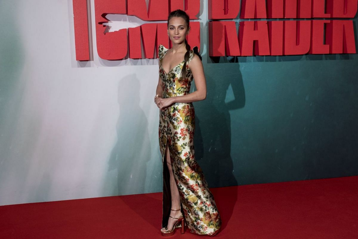 Alicia Vikander, seen here attending the European premiere of Tomb Raider in London on Tuesday, says she played the game in her teens.