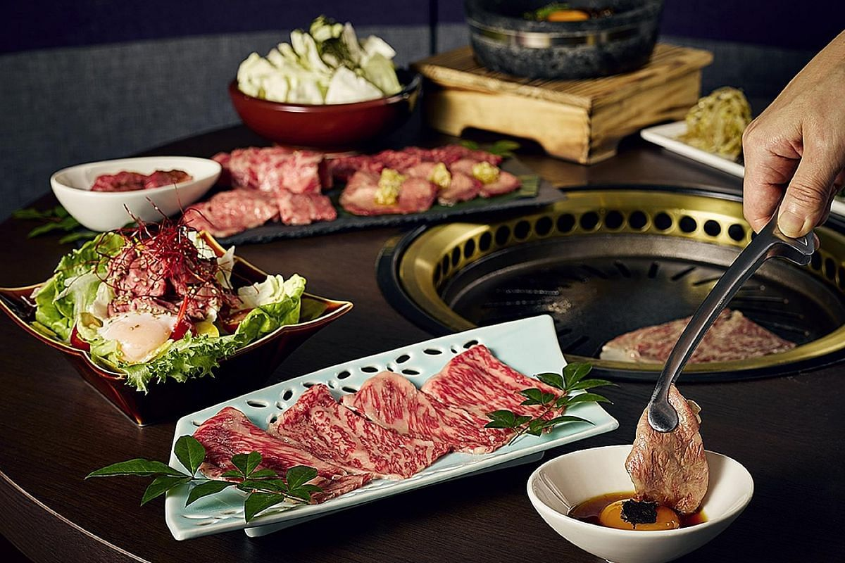 The Gyu Bar serves Omakase Beef Platter (above), which comprises a 300g selection of cuts, and Buta Don (below), rice topped with grilled pork neck and pork belly.
