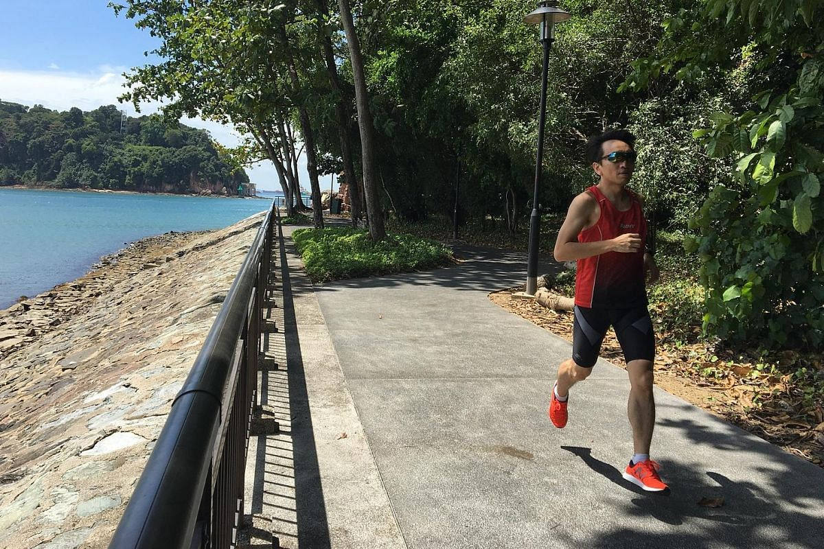 Mr Vincent Lim on his favourite route in Labrador Park, for a virtual run organised by local start-up 42Race. Home-grown start-up 42Race - which includes co-founders Augustine Chua (back row, seventh from right) and Zhou Mi (front row, second from ri