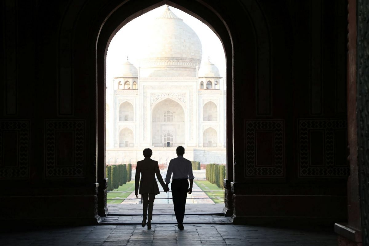 French President Emmanuel Macron and his wife Brigitte Macron are seen at the Taj Mahal in Agra, India March 11, 2018. PHOTO: REUTERS