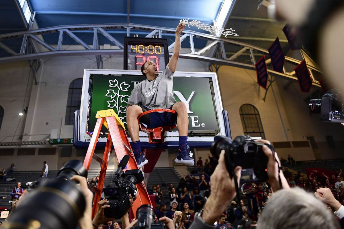 Darnell Foreman #4 of the Pennsylvania Quakers sits atop the cylinder after the win of the Men's Ivy League Championship Tournament at The Palestra on March 11, 2018 in Philadelphia, Pennsylvania. Penn defeated Harvard 68-65. PHOTO: GETTY IMAGES/AFP