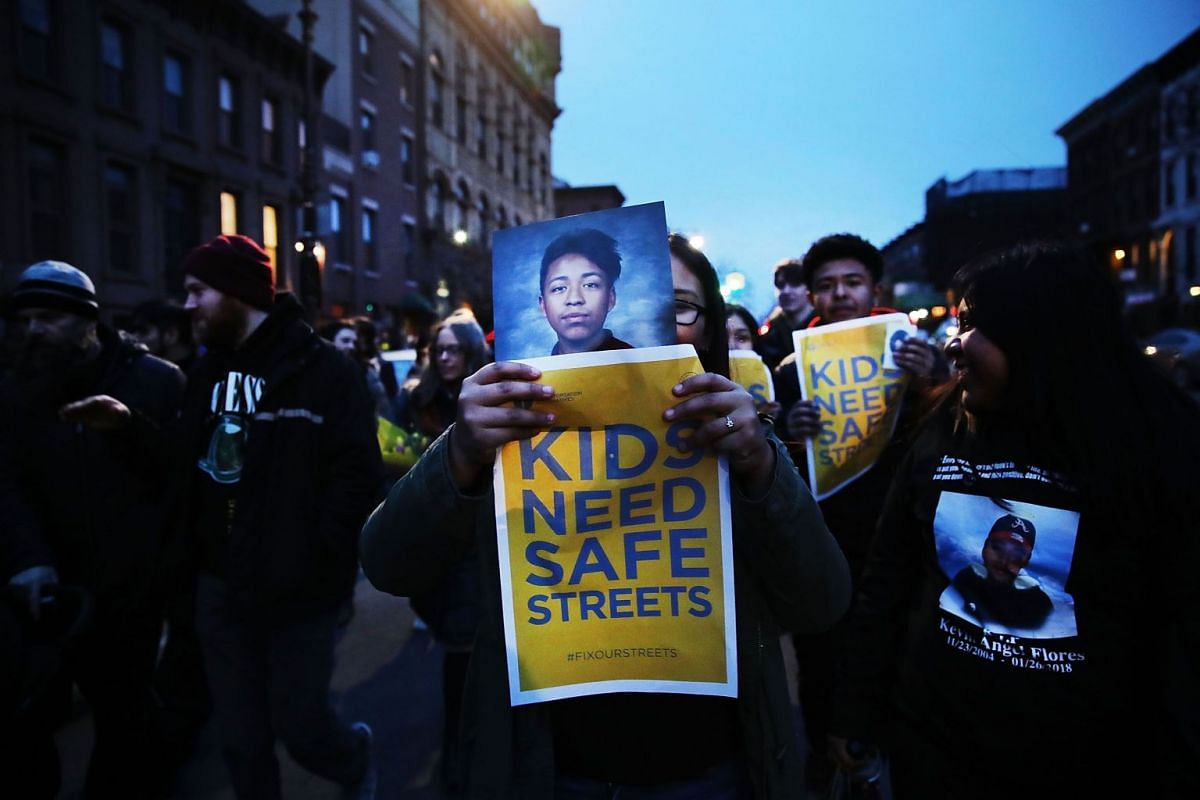 The family of Kevin Flores, who was killed by a car while on his bike, join hundreds of residents, children, activists and politicians at a March for Safe Streets following a recent accident where two small children were killed by a car driver, March