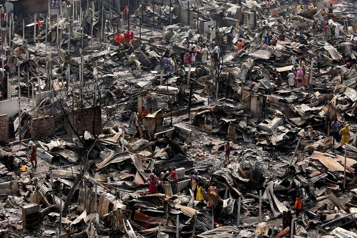 A view of fire gutted shanties at the Ilias Mollah Slum in Mirpur-12, Dhaka, Bangladesh, March 12, 2018. PHOTO: EPA-EFE
