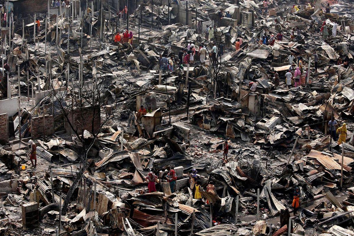 A view of fire gutted shanties at the Ilias Mollah Slum in Mirpur-12, Dhaka, Bangladesh, March 12, 2018. PHOTO: EPA-EFE