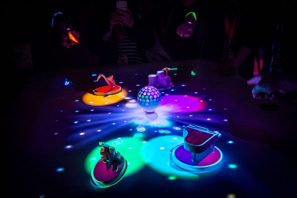 Attendees play Light Up on the Beat, a game played on the Interactive Tabletop Projector, inside the Sony Corp. Wow Studio during the South By Southwest (SXSW) conference in Austin, Texas, U.S., on Monday, March 12, 2018. PHOTO: BLOOMBERG