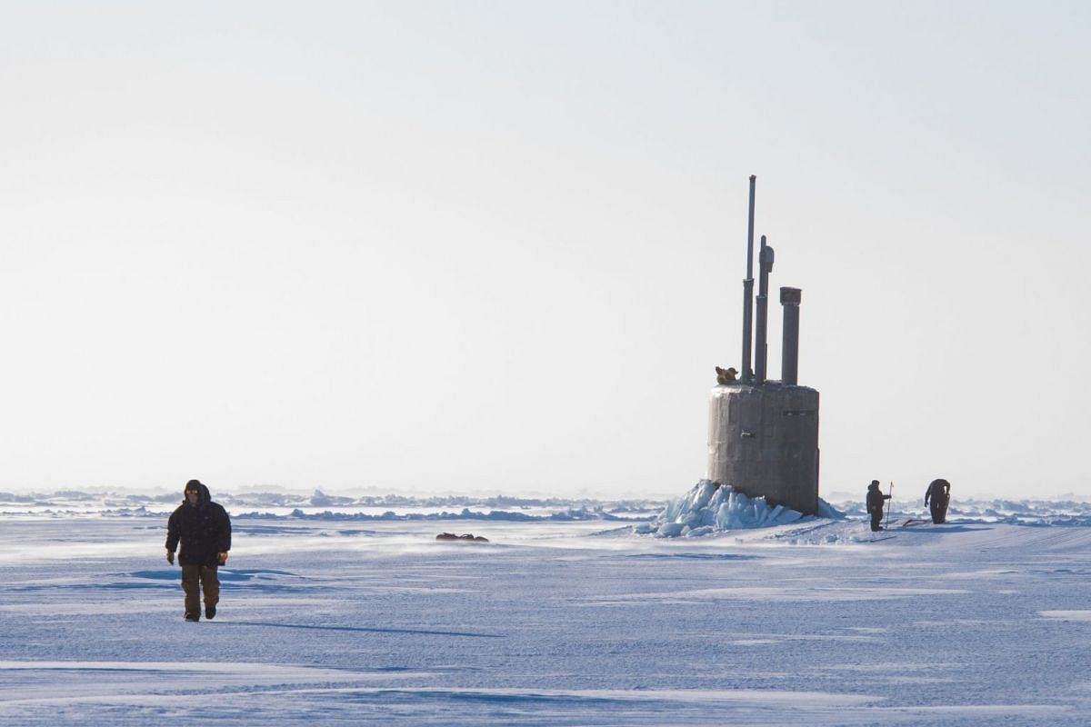 This US Navy photo released on March 12, 2018 shows the Seawolf-class fast-attack submarine USS Connecticut (SSN 22) as it breaks though the ice in the Beaufort Sea in support of Ice Exercise (ICEX) on March 10, 2018. PHOTO: U.S. NAVY VIA AFP
