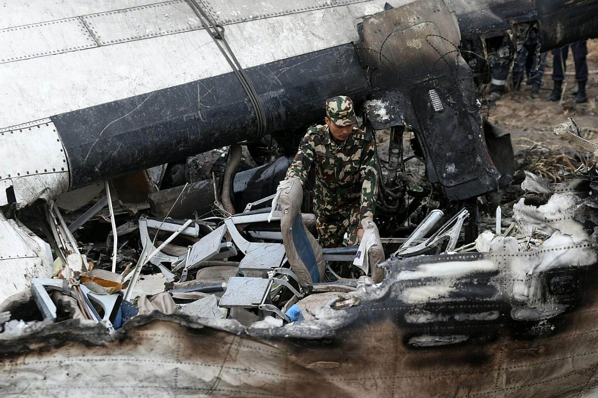 Several people had been rescued from the burning wreckage of the Bombardier Q400 series aircraft but nine people were still unaccounted for.