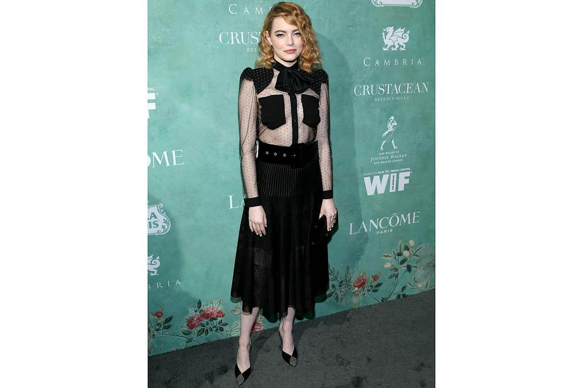 Emma Stone in a Givenchy Fall 2018 outfit, designed by Clare Waight Keller at the 11th Women in Film Annual Oscars Celebration.