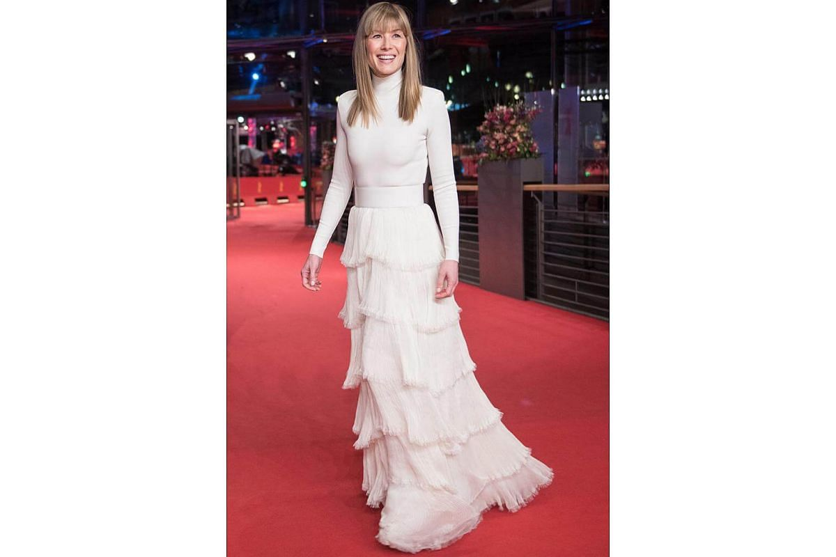 Actress Rosamund Pike in a Givenchy Haute Couture Spring-Summer 2018 look, designed by Clare Waight Keller at the 7 Days In Entebbe world premiere at the Berlinale International Film Festival.