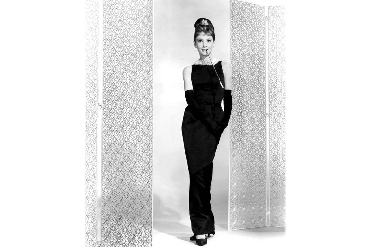 Audrey Hepburn on the set of Breakfast At Tiffany's with her iconic black Givenchy dress, which was sold at a charity auction at Christie's in London for US$923,187 in 2006.