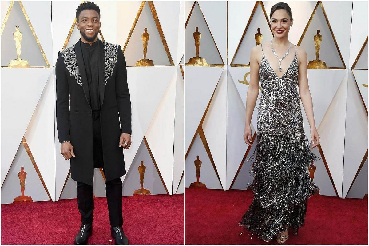 Actors Chadwick Boseman and Gal Gadot in custom made Givenchy Haute Couture outfits.